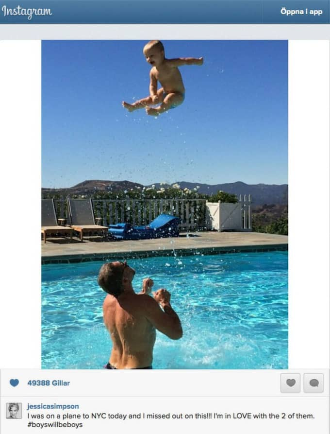 ... efter att hon publicerat en bild där maken kastar upp deras bebis högt i luften.