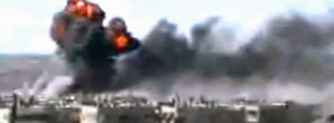 Bombregnet över Homs. Foto: AP