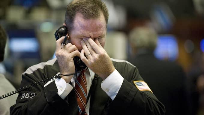 En finansmäklare på golvet på New York Stock Exchange, september 2008, när den globala finanskrisen var ett faktum. Foto: RICHARD DREW/AP
