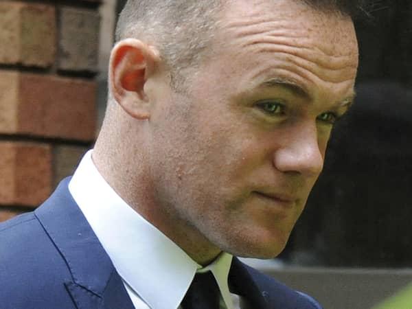 Rooney hanades av de egna supportrarna