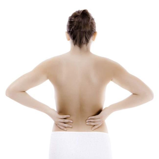 smärta längst ner i ryggen