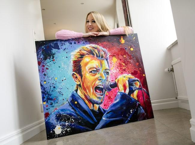 """<span>I början av året ställde Marie ut på lyxhotellet Caesars Palace i Las Vegas – en utställning så framgångsrik att hon nu fått en egen vägg på hotellets konstgalleri.</span> <span>Tavlan """"Bowie"""" finns att köpa i LEVA&BO:s webbutik. Klicka på plustecknet i bilden för att handla.</span> <span><br></span>"""