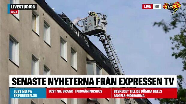 Fullt utvecklad brand i tiovåningshus