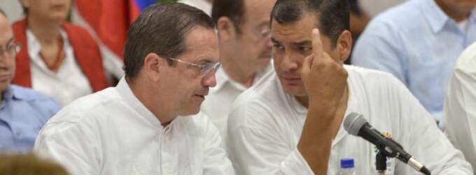 Ecuadors president Rafael Correa och utrikesminister Ricardo Patino under mötet i den latinamerikanska samarbetsorganisationen ALBA. Foto: Rodrigo Buendia/AFP/Scanpix