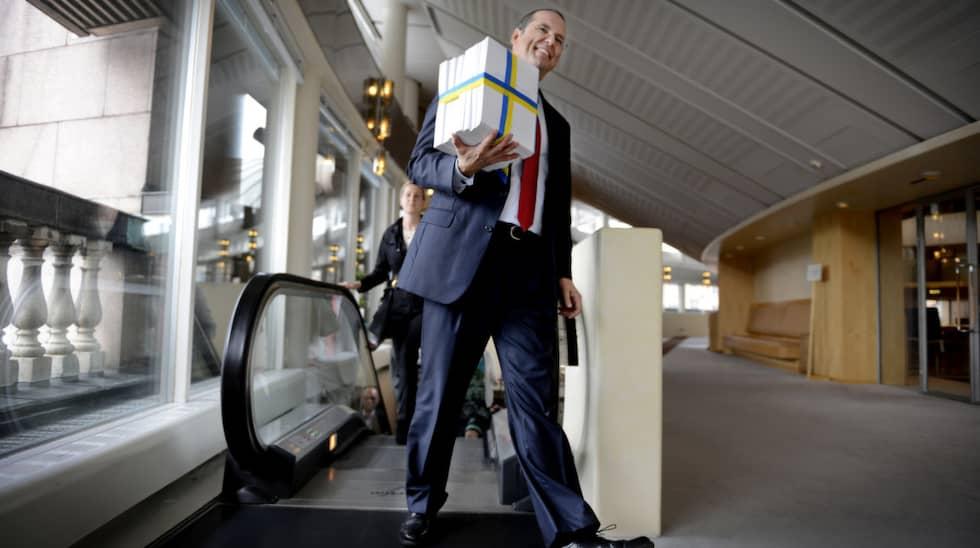 Anders Borg, dåvarande finansminister, presenterar höstbudgeten i riksdagen 2013. Foto: Robban Andersson